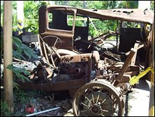 Burnt-out car on the Napoles estate