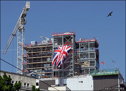 Rangers fans somehow manage to drape a huge Union Flag from a city centre construction
