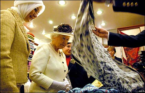 The Queen looking at silk in a shop