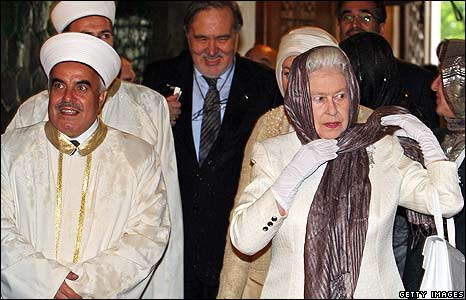 The Queen wears a headscarf during a visit to a mosque