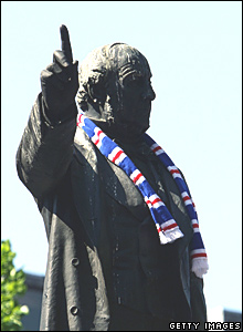 A statue of Prince Albert is draped in Rangers colours