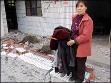 Xiao Min outside her home