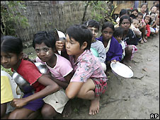 Children wait to receive food aid from local donors in Rangoon - 14/5/2008