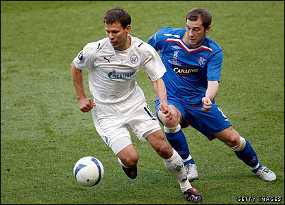 Zenit's Konstantin Zyrianov shields the ball from Kevin Thomson