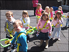 Nursery children using the Walkodile