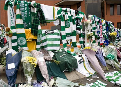 Flowers, scarves and strips are left outside Celtic Park