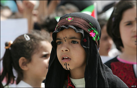 Palestinian girl dressed in traditional clothes in ceremony in Gaza City