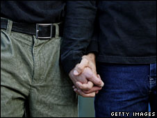 Two men hold hands (file image)