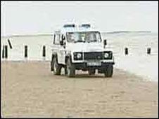 Environment Agency Land Rover on beach