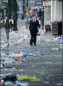 People walk to work through the layers of rubbish