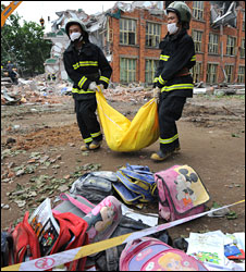Rescue workers with a body bag outside a school in Hanwang 15 May