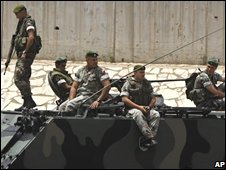 Lebanese soldiers on armoured personnel carrier on road to Beirut airport