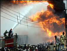 Firemen attempt to put out flames outside Lagos, Nigeria, 15 May, 2008