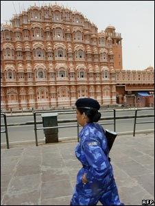 A soldier stands guard in front of Jaipur's landmark Hawa Mahal during the curfew