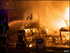 A fire burns in a Roma camp in the Ponticelli district of Naples, Italy (May 13)