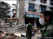 A man surveys the damage in a town ripped apart by the earthquake in China