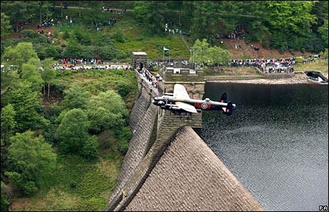 """A Lancaster bomber swoops over Derwent dam in Derbyshire to mark the 65th anniversary of the """"dambuster"""" raid over Germany in 1943."""