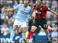 Man City midfielder Martin Petrov takes on Fulham's Danny Murphy