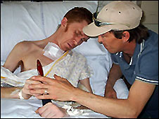 Garry Reynolds in hospital with his brother, Graeme