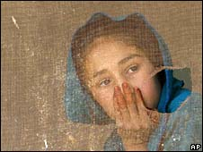 Afghan girl looks out of window of school in Bagram, 24 March 2008
