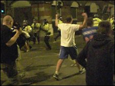 Rangers fans confronting police armed with riot shields