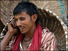 Indian labourer using a mobile phone