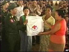 An unidentified Burmese general hands out food bags in a shelter. Image taken from state run television station MRTV-3