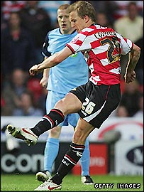 Doncaster midfielder James Coppinger scores one of his three goals in the win over Southend