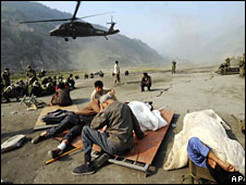 Wounded earthquake survivors wait to be evacuated by helicopter in Sichuan province, 16 May, 2008