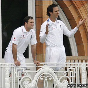 Andrew Strauss and Michael Vaughan look out from the England balcony as the start is delayed