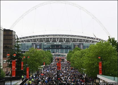 Fans make their way from Wembley Park station to the stadium
