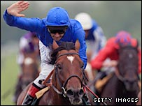 Frankie Dettori salutes his victory in the Juddmonte Lockinge Stakes