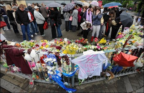 Floral tributes and crowds