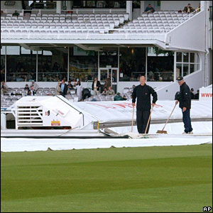 Ground staff work on the square at Lord's as the rain continues