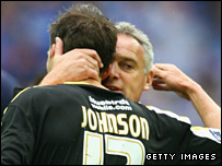 Cardiff boss Dave Jones comforts defender Roger Johnson