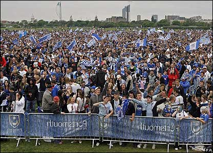 Pompey fans gather to watch the match