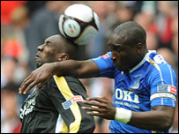 Cardiff's Jimmy Floyd Hasselbaink tangles with Sol Campbell at Wembley