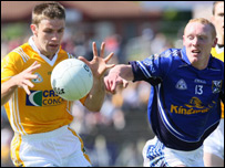 Tony Scullion (left) and Cavan's Cian Mackey