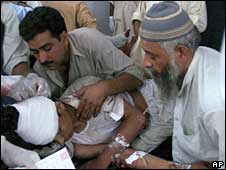 An injured victim of Mardan's suicide bombing is treated at a local hospital in Peshawar, Pakistan