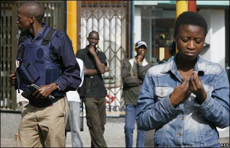 A policeman patrols outside a church in Johannesburg on 18 May 2008
