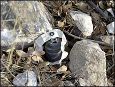 A cluster bomb dropped by Israel in Lebanon during the 2006 conflict lies by the roadside