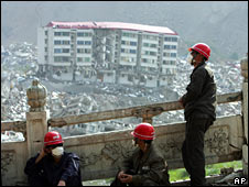 Rescue workers in Beichuan take a break on 18 May 2008