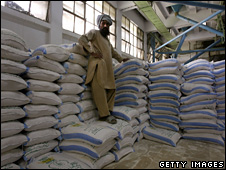 A flour wholesaler waits to collect bags of flour at a flour mill in Pakistan