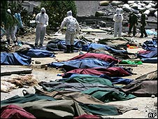 Earthquake victims lie in body bags in Beichuan on 18 May