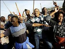 Group of South Africans wielding sticks in Reiger Park, outside Johannesburg