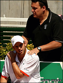 Andy Roddick receives treatment at the Rome Masters