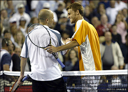 Gustavo Kuerten shakes hands with Andre Agassi