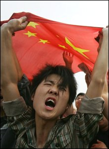 Man cheers at Tiananmen Square gathering
