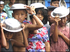 Cyclone survivors wait for food in Laputta town, Irrawaddy Delta, 15 May 2008