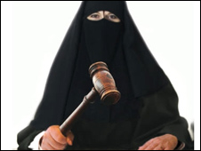 Poster of a woman wearing a burka (image with permission from DPP)